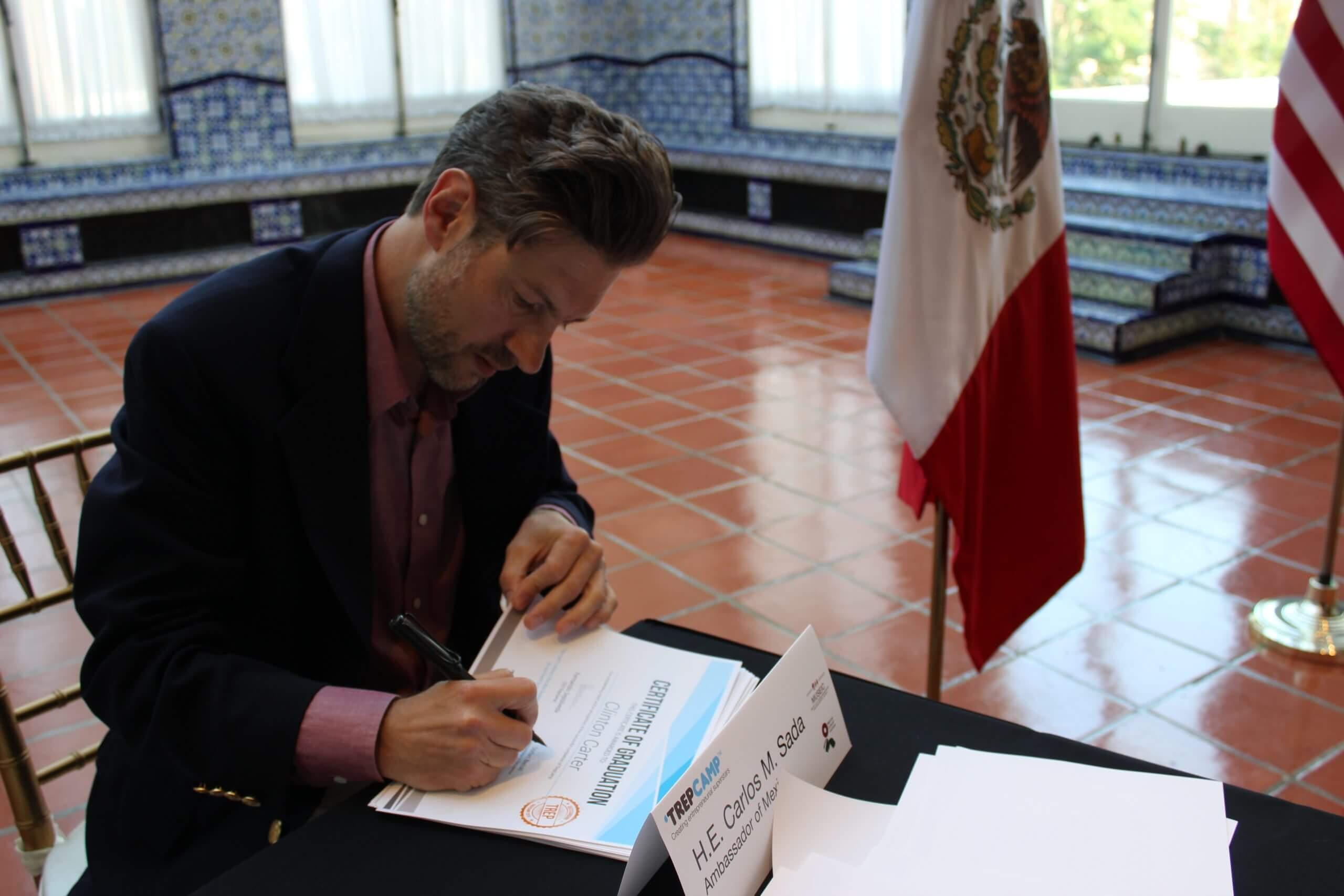 Stefan signs diplomas